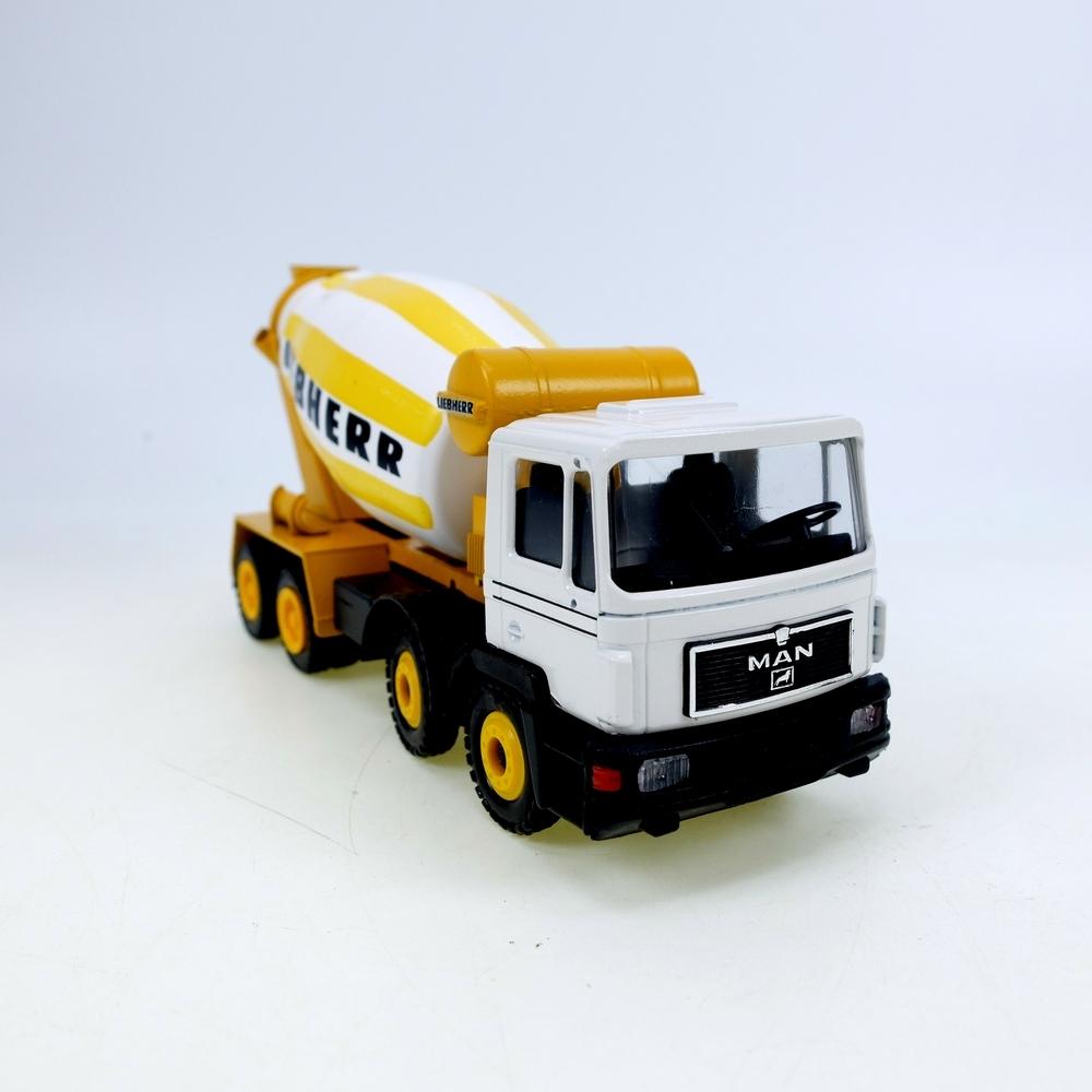 Liebherr HTM 904 MAN gelb-weiß